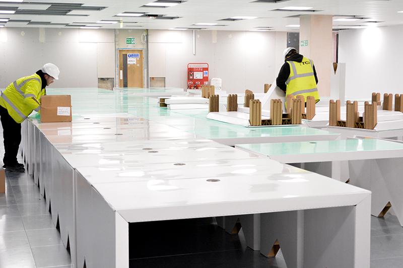 cardboard-furniture-installation-sustainable-office-future-construction